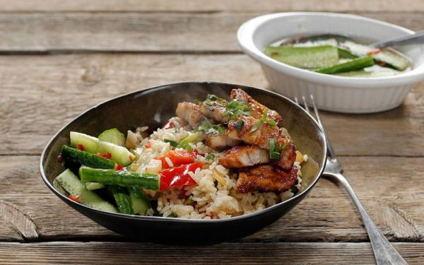 Asian pork belly and rice with vegetables and sweet-and-sour cucumber