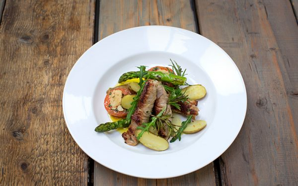 Saltimbocca with fried tomatoes, asparagus and new potatoes