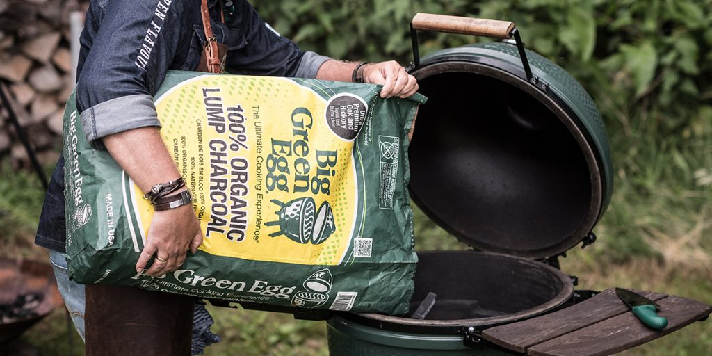 putting Premium Organic Lump Charcoal in the big green egg