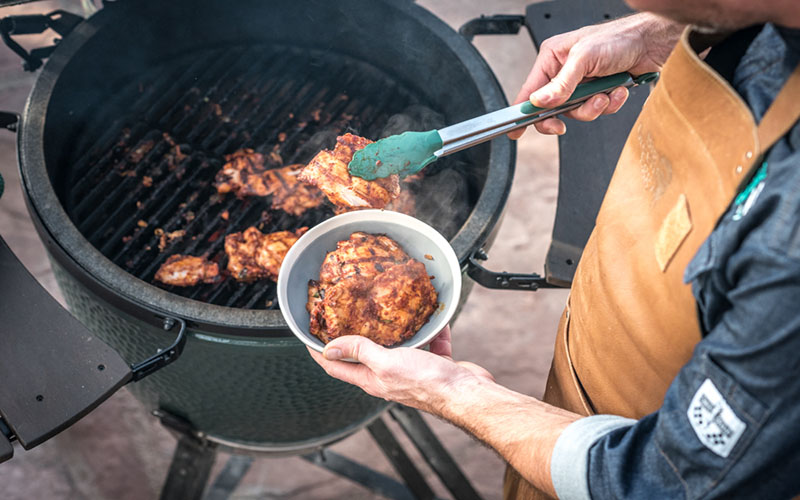 Taking them chicken out of the big green egg