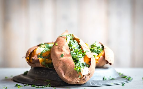 Big Green Egg Baked sweet potatoes with feta and parsley