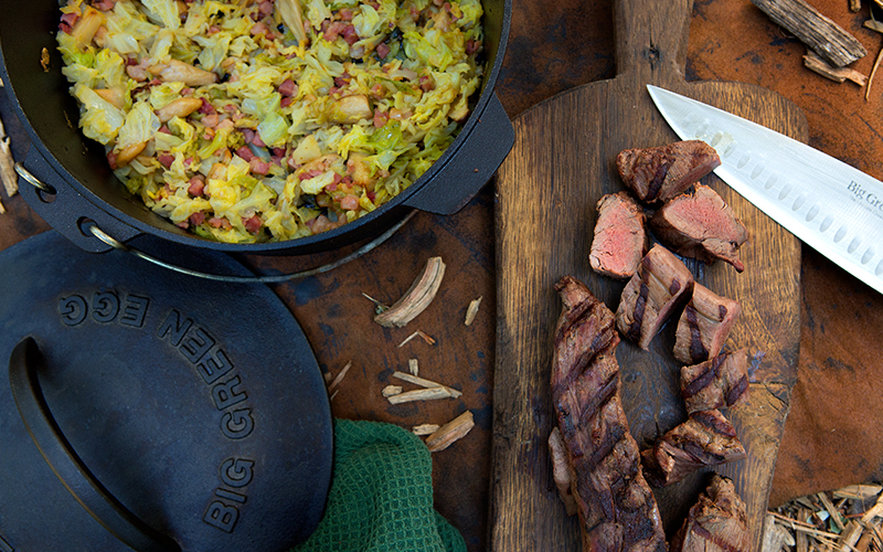 Big Green Egg Grilled wild boar tenderloin with fried green cabbage and bacon