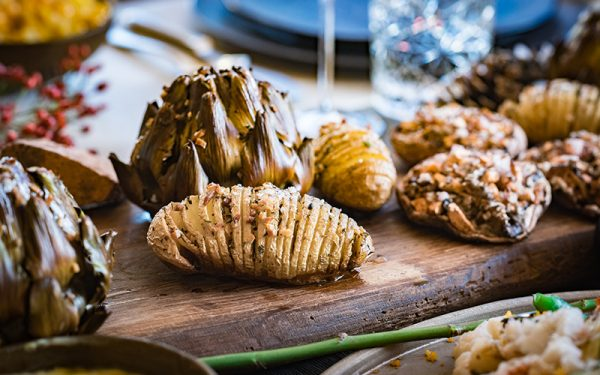 Roasted Hasselback potatoes with herb oil