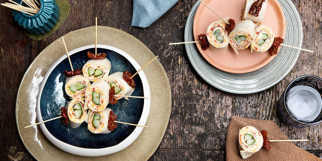 Wrap rolls with cream cheese, Parma ham and grilled cucumber